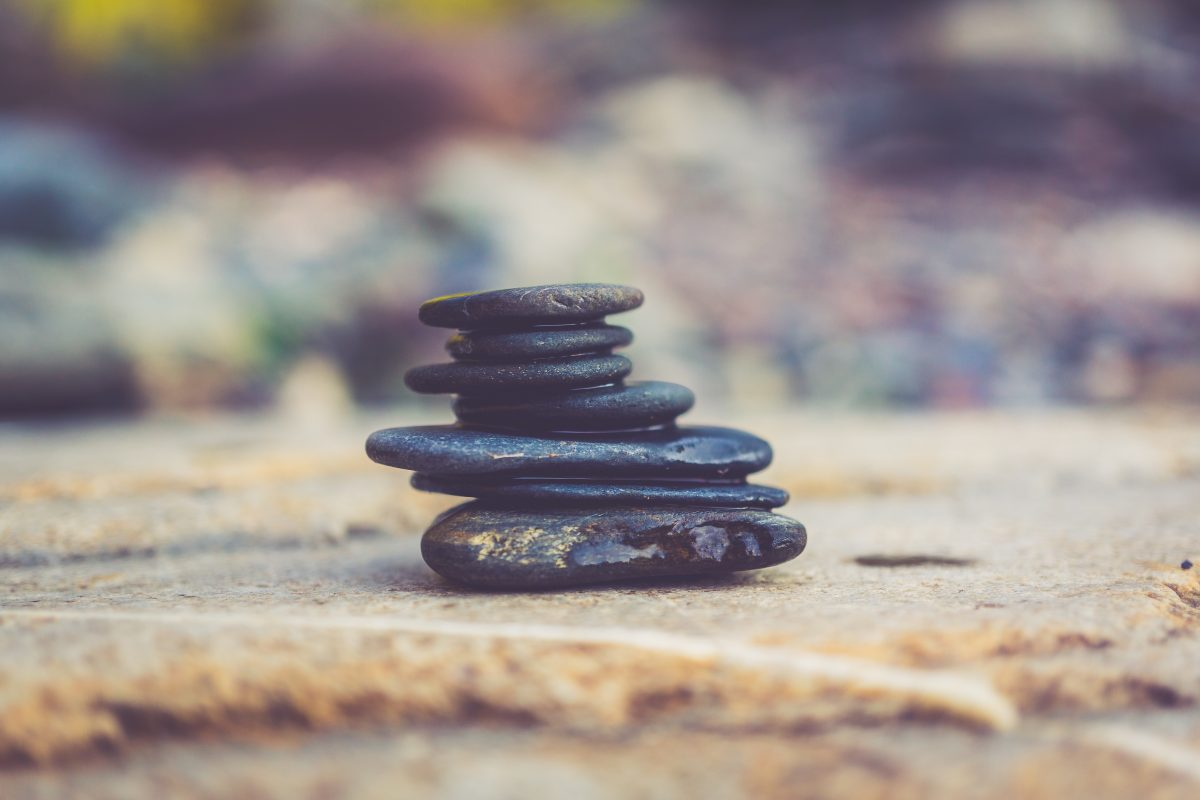 Stacked stones. Photo by Aperture Vintage on Unsplash